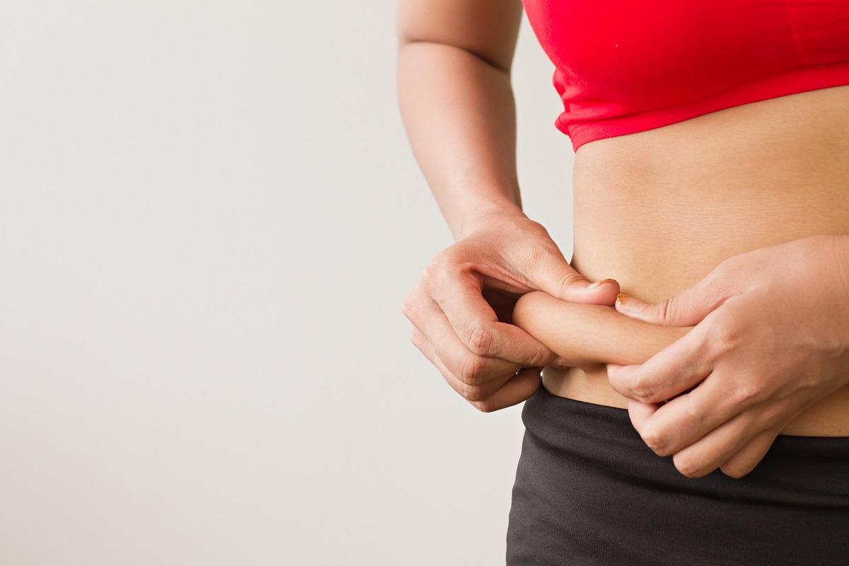 Woman pinching her tummy