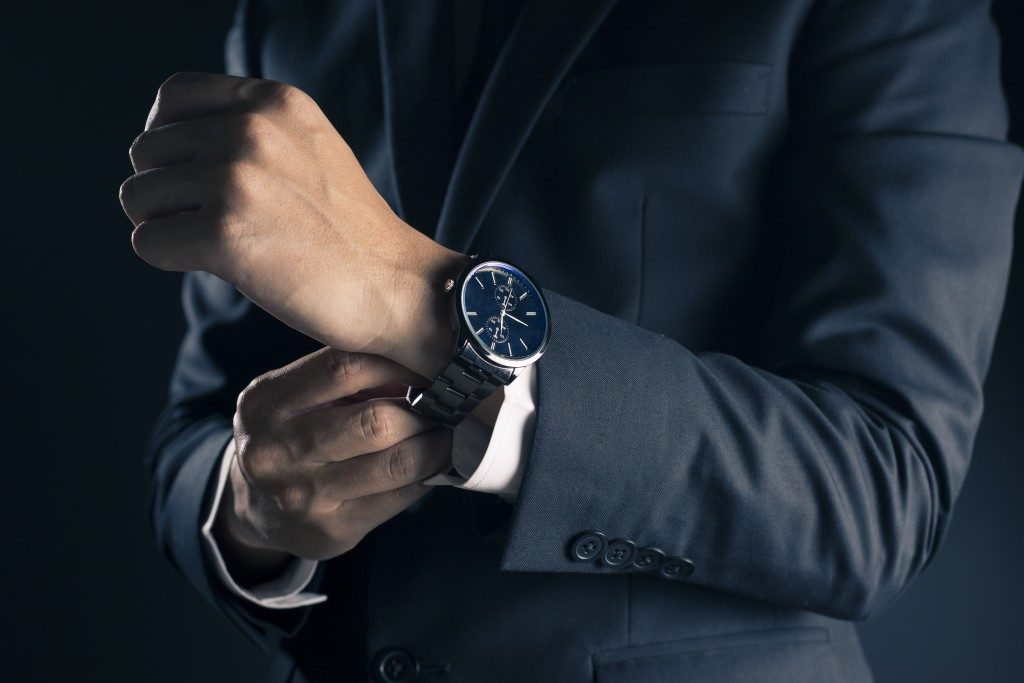 Man on a suite wearing a watch