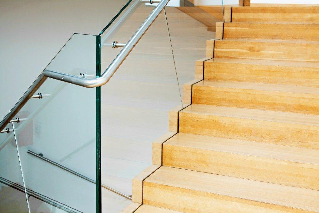 Modern architecture interior with elegant wooden stairs