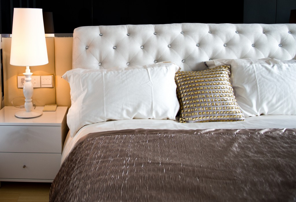 king sized bed with white headboard