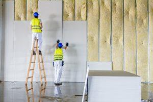 men installing wall panels