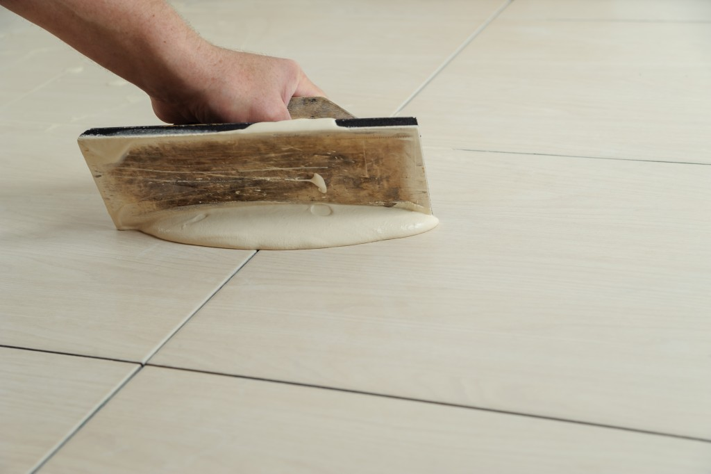 putting grout on tiles