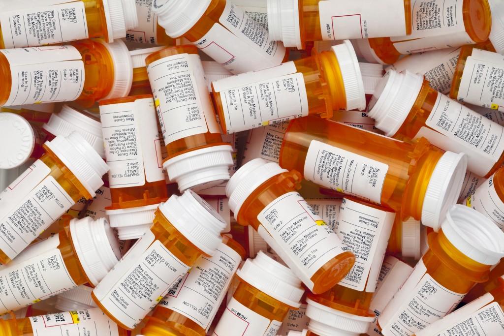 Stacks of prescription bottles