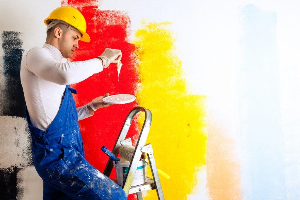 worker using paint