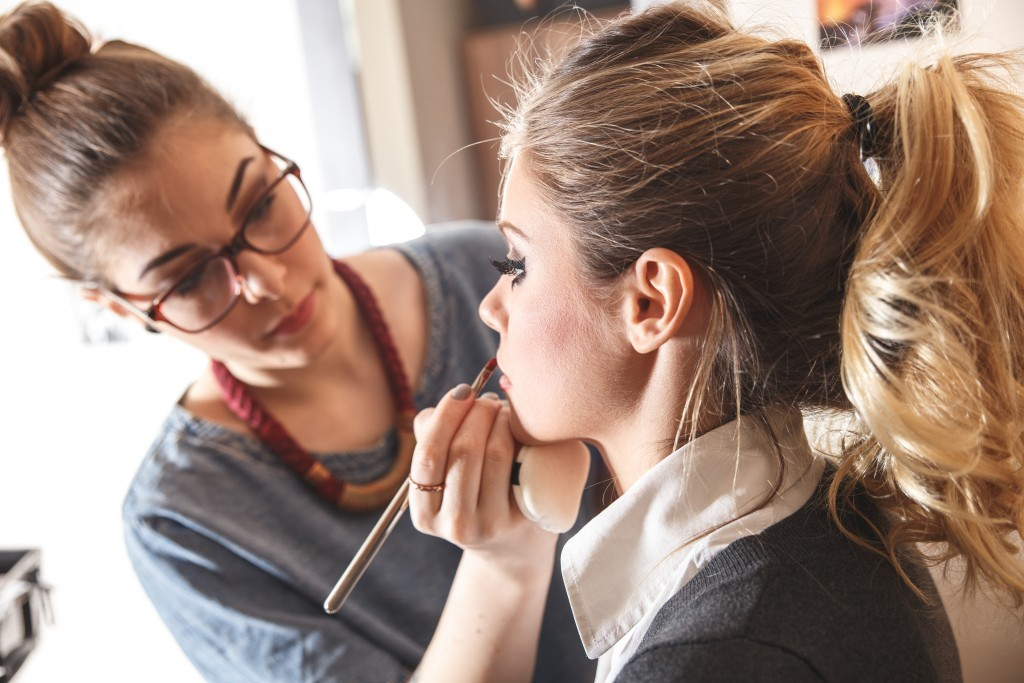 Make-up artist work on her friend