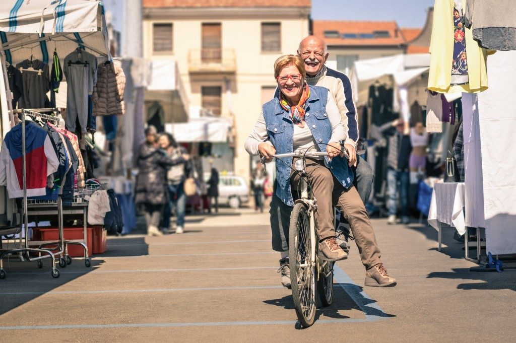 senior couple having fun with bicycle