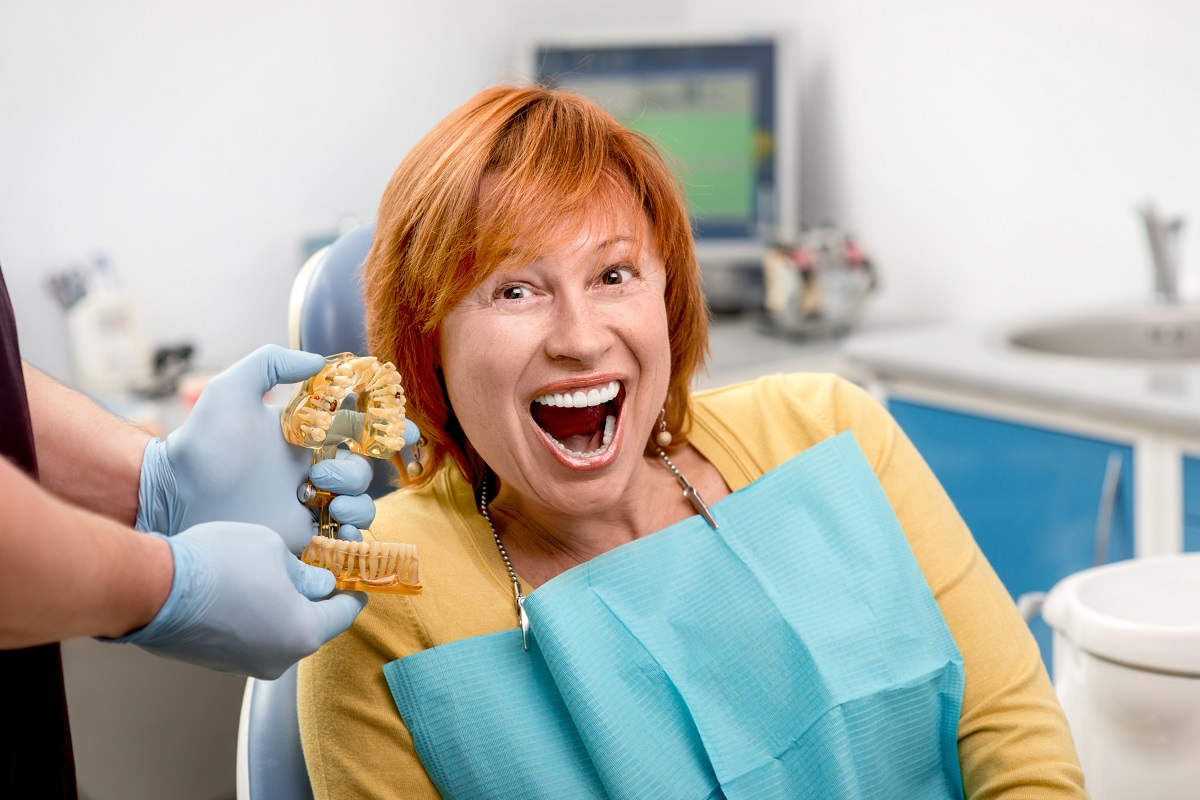 woman smiling with her teeth mold