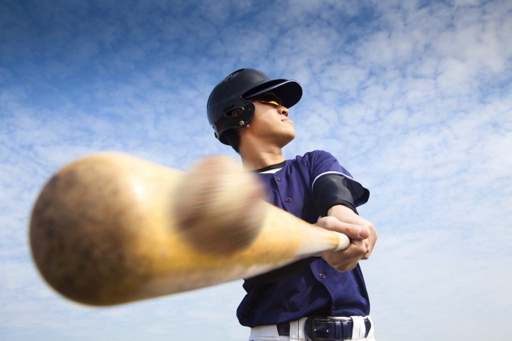 Man hitting the ball with a bat