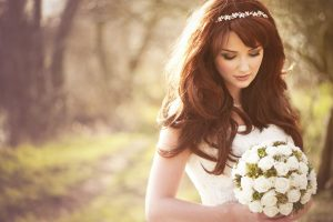 Woman in her wedding dress in a garden background