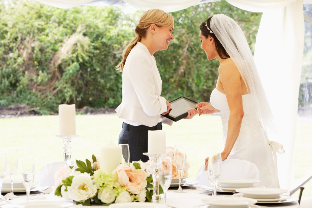 Bride talking to her wedding planner