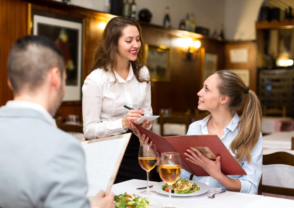 waiter taking the customer's orders in a restaurant