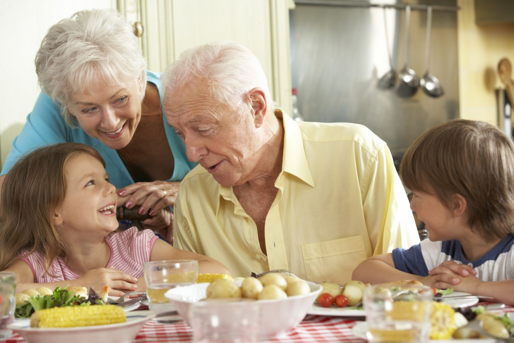 grandparents having lunch with their grandkids