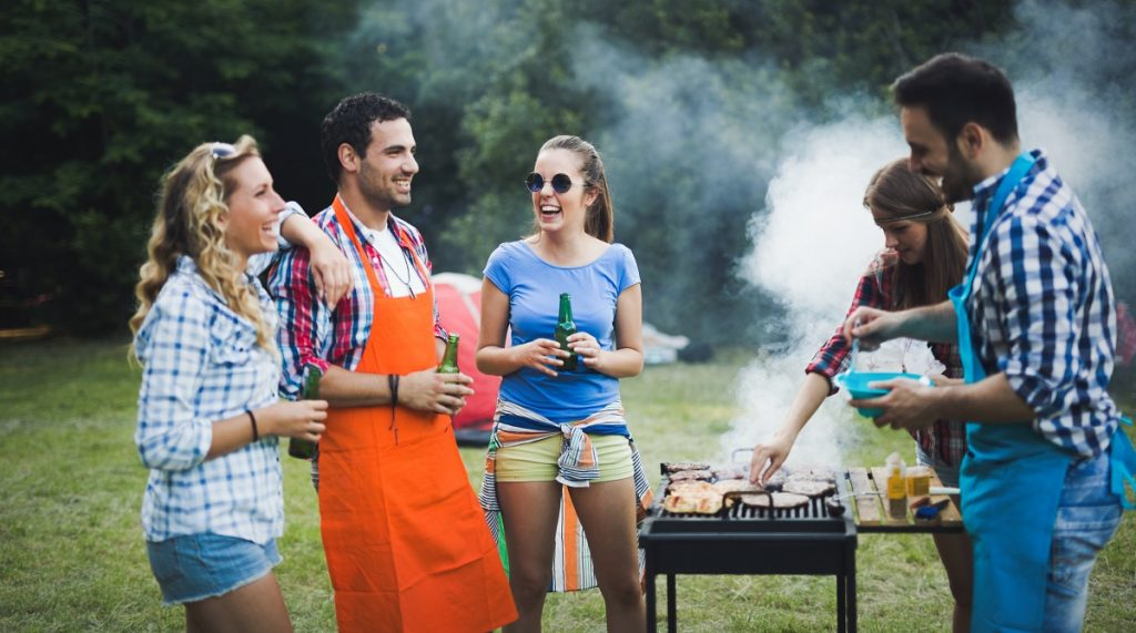 people having a backyard barbecue party