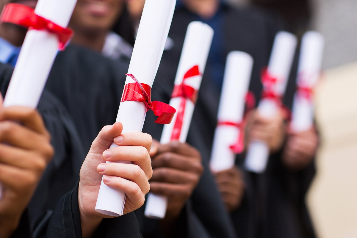 college graduates holding diploma