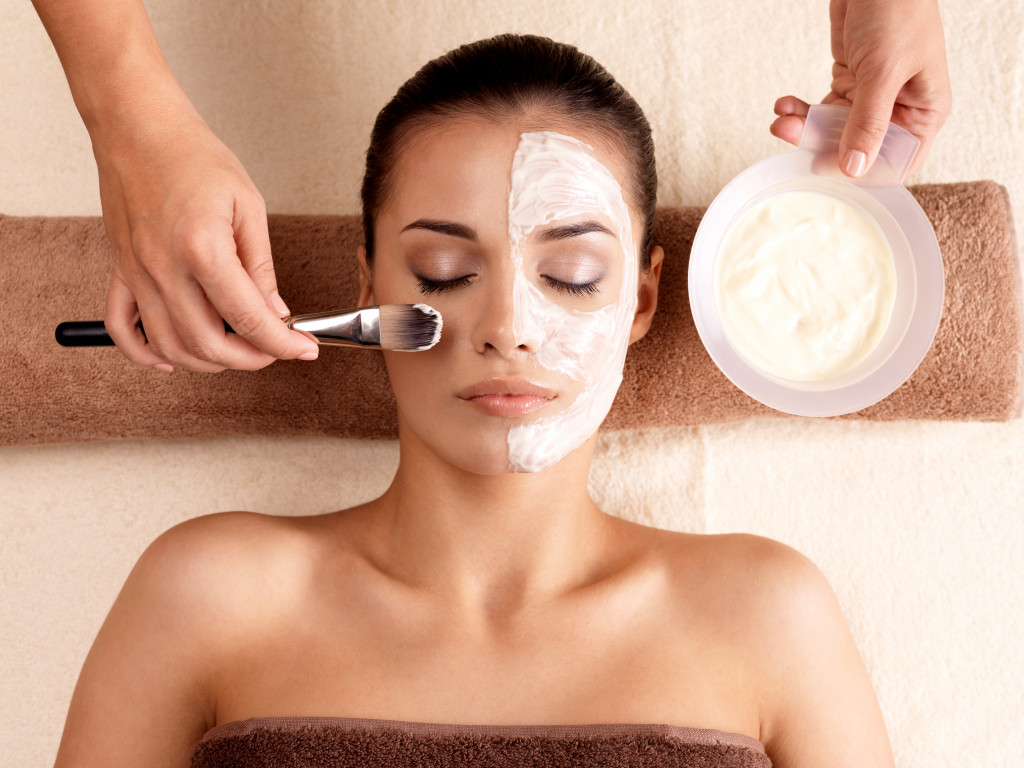 woman having a facial at spa