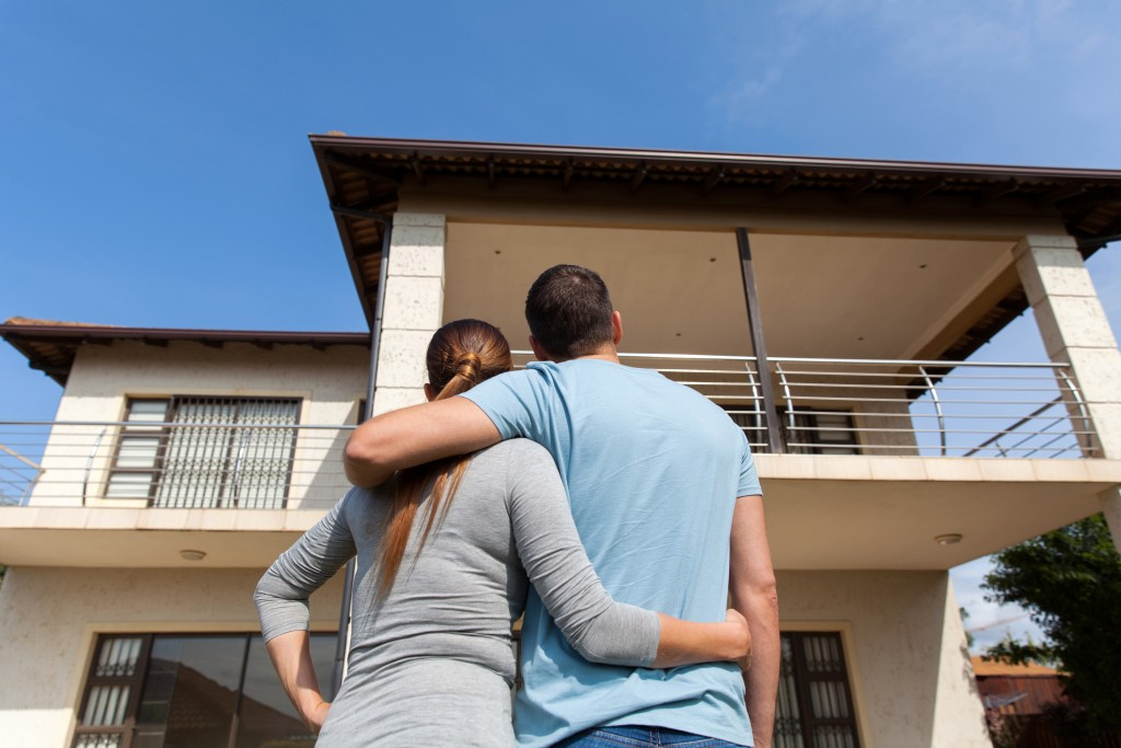 couple with new house