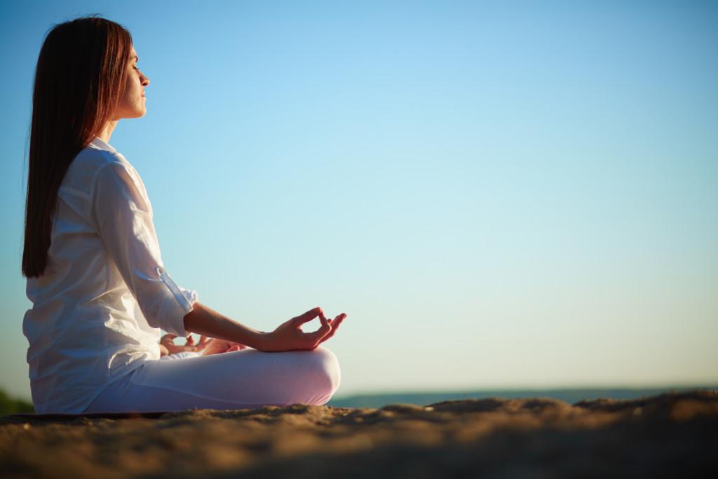 woman meditating outdoor