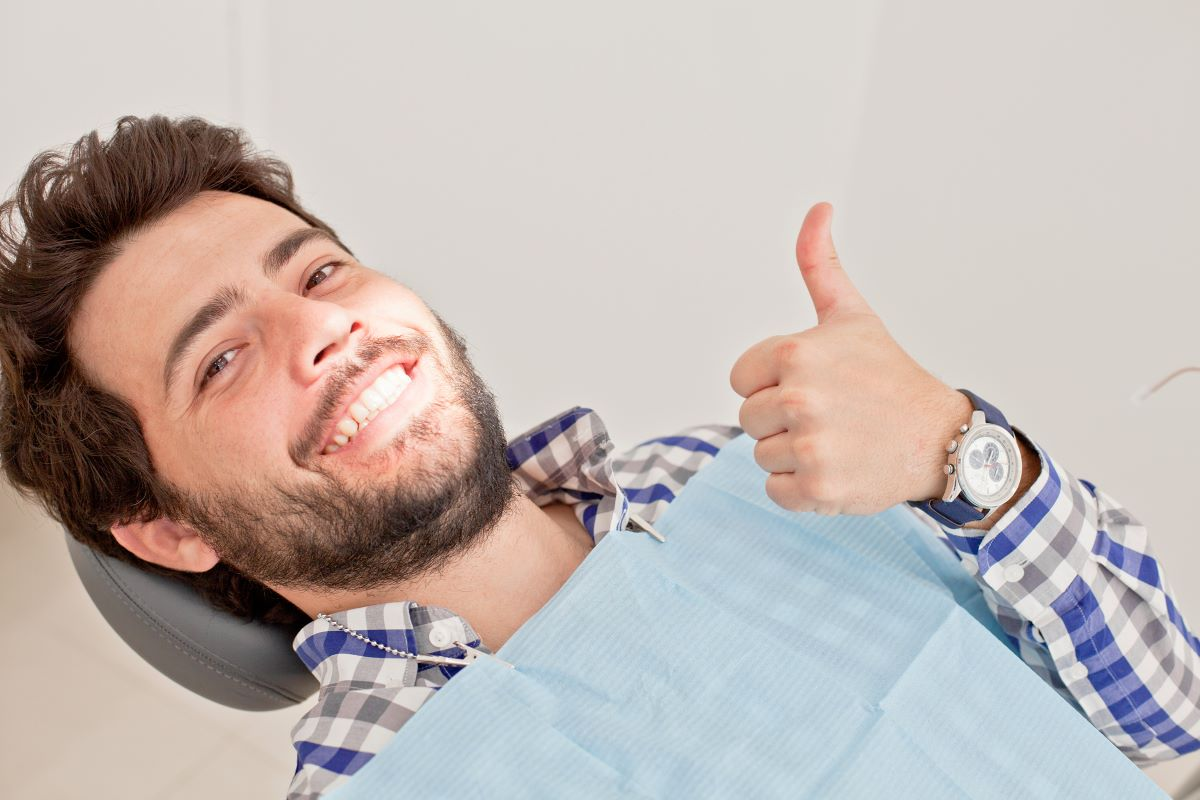 man smiling with thumbs up