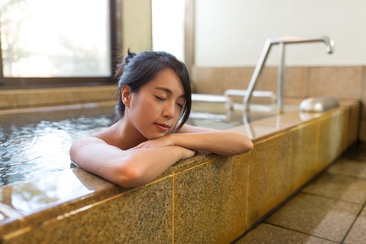 woman relaxing on a bathtub