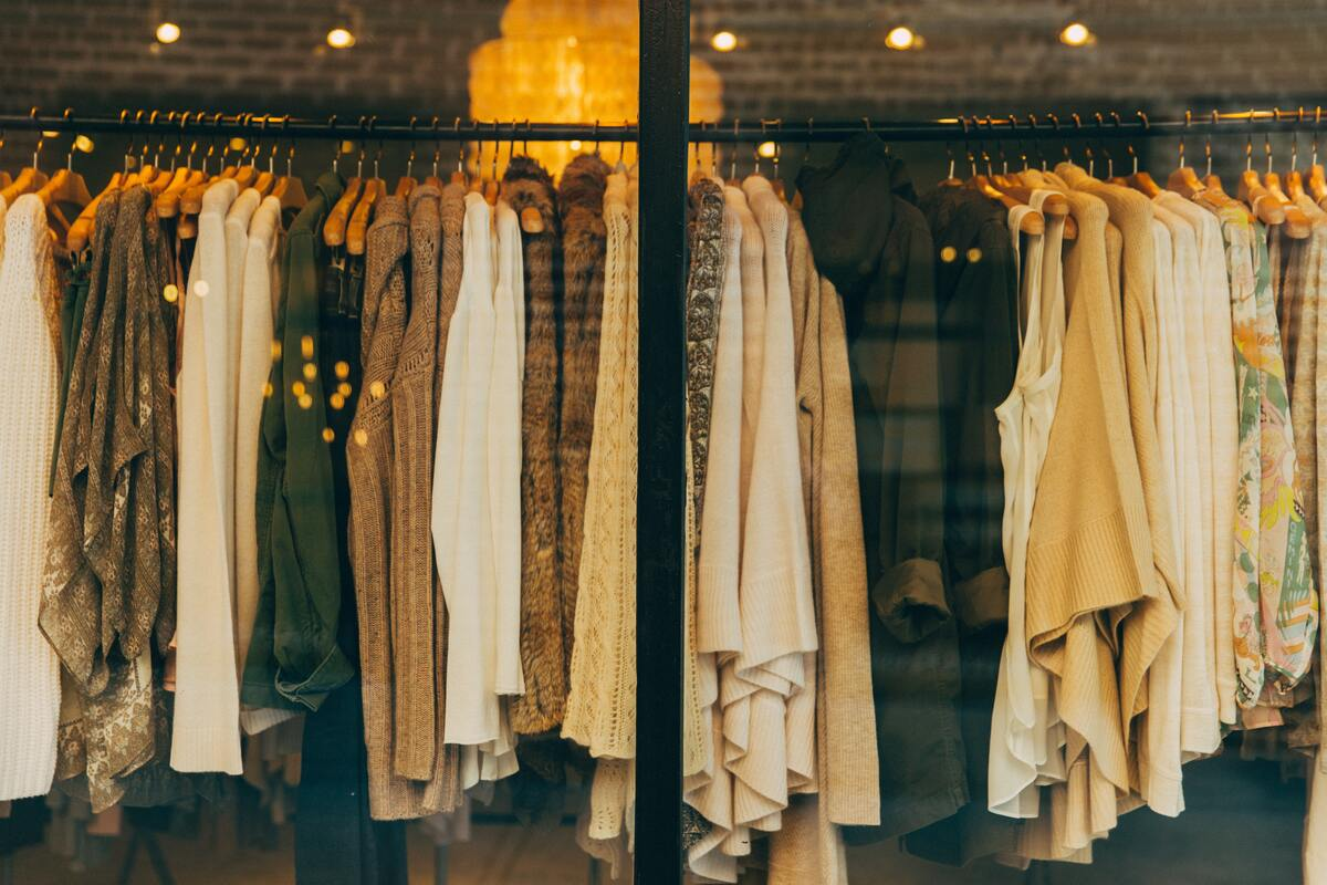 rack full of neutral color clothes