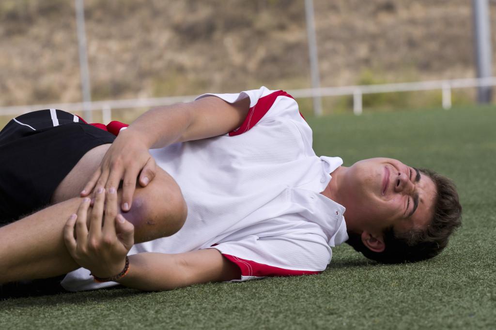 football player taking an injury